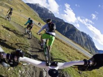 Italy Livigno View of woman and man riding mountain bike downhill model released PUBLICATIONxINxGE