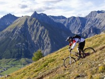 Italy Livigno View of man riding mountain bike downhill model released PUBLICATIONxINxGERxSUIxAUTx