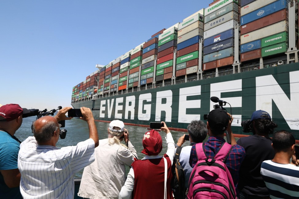 (210707) -- ISMAILIA, July 7, 2021 -- People take photos of the Ever Given container ship sailing on the Suez Canal in I