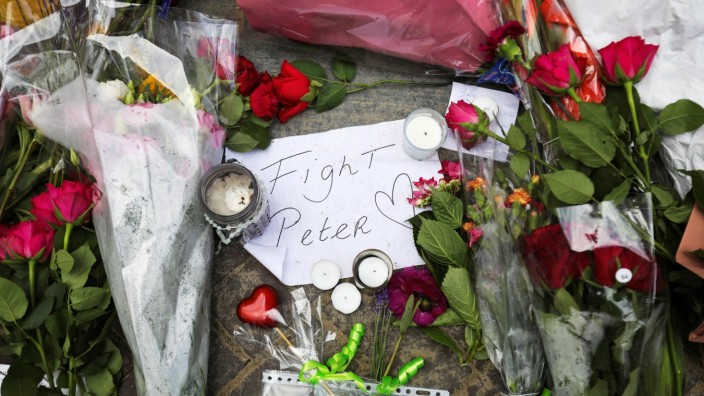 People leave flowers where Dutch crime reporter de Vries has been shot and reported seriously injured in Amsterdam