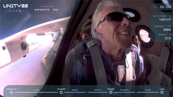 Billionaire Richard Branson smiles on board Virgin Galactic's passenger rocket plane VSS Unity