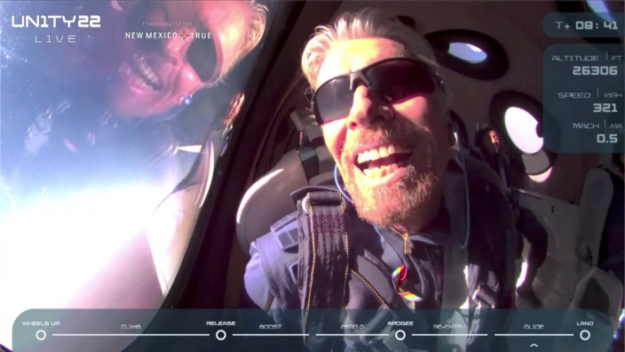 Billionaire Richard Branson reacts on board Virgin Galactic's passenger rocket plane VSS Unity after reaching the edge of space above Spaceport America
