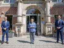 German Chancellor Angela Merkel visits RKI in Berlin