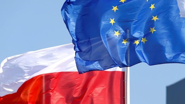 FILE PHOTO: EU and Polish flags flutter in Mazeikiai