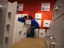 Workers carry a wall safe at Hamburger Stahltresor GmbH in Hamburg