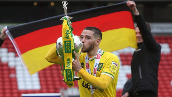 Barnsley v Norwich City Sky Bet Championship Emiliano Buendia of Norwich with the EFL Championship trophy at the end of; Buendia