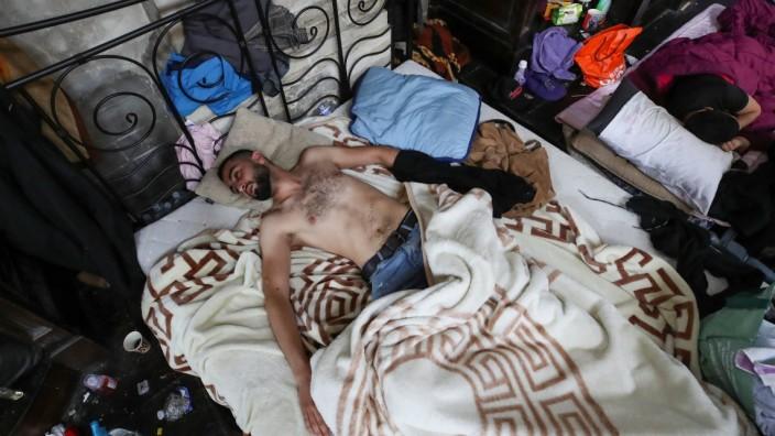 Asylum seekers taken part in a hunger strike, in Brussels