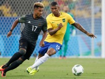 Germany midfielder Serge Gnabry 17 and Brazil midfielder Wallace 12 battle for a ball in the fir