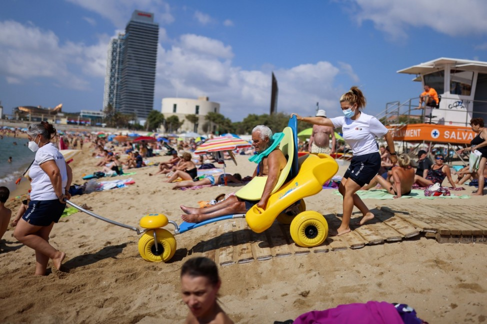 Doing swimmingly! Barcelona helps disabled beachgoers frolic in waves