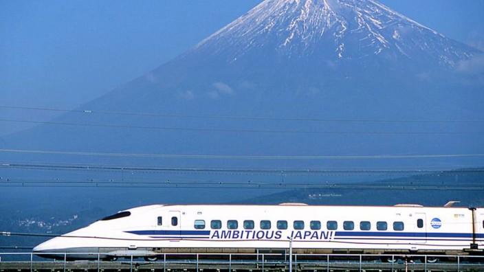 File photo of Japan's bullet train speeding past Mount Fuji in Fuji city, west of Tokyo