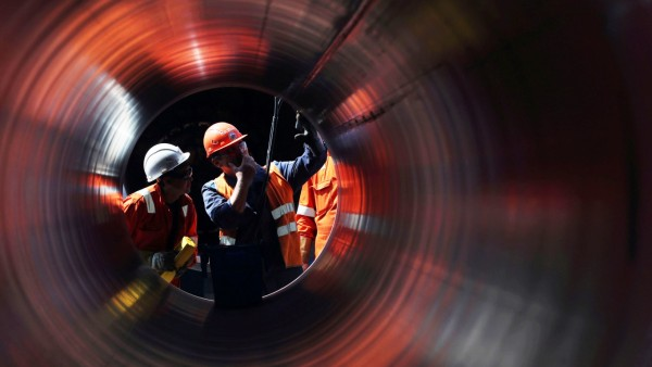 FILE PHOTO: Workersare seen through apipeat theconstruction siteof the NordStream2 gas pipeline in Russia