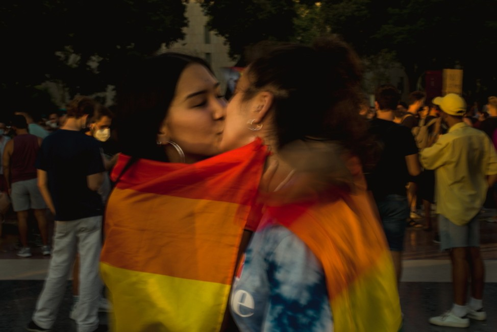 July 22, 2021, Barcelona, Catalonia, Spain: Two girls kiss during a demonstration of the LGTB community after the recent