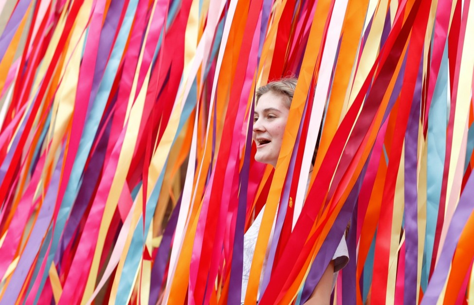 A festivalgoer walks through ribbons at Latitude Festival at Henham Park