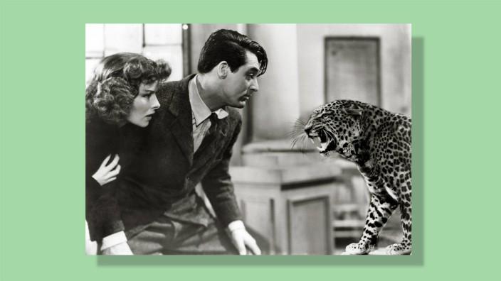 """Kolumne """"Nichts Neues"""": Gut drin, unbeschreiblich gut auszusehen und gleichzeitig so zu wirken, als täte er das nicht: Cary Grant, hier in """"Bringing Up Baby"""" mit Katharine Hepburn und Leopard Baby."""