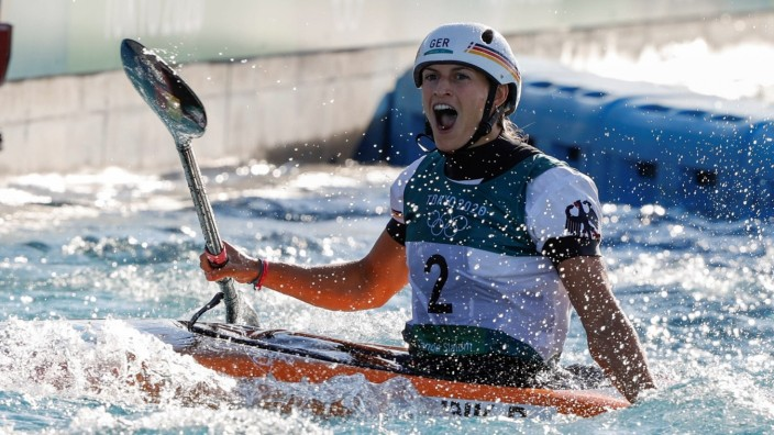 Germany s Ricarda Funk celebrates after winning the gold medal in the women s kayak final for canoeing in slalom during