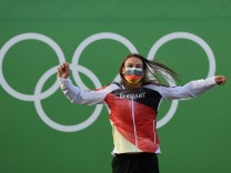 Germany s Ricarda Funk celebrates on the podium after winning the gold medal in the women s kayak final for canoeing in