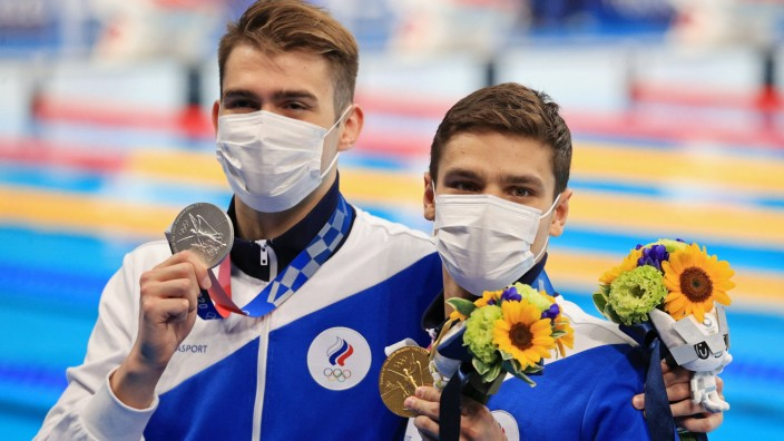 TOKYO, JAPAN - JULY 27, 2021: ROC athletes Kliment Kolesnikov (L) and Yevgeny Rylov pose with their silver and gold meda