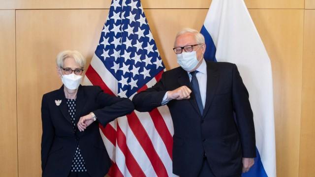 U.S. Deputy Secretary of State Sherman and Russian Deputy Foreign Minister Ryabkov before a meeting in Geneva