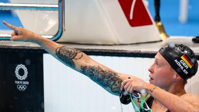 TOKYO, JAPAN - JULY 28, 2021: German swimmer Sarah Kohler celebrates as she wins bronze in the ladies 1500m freestyle fi