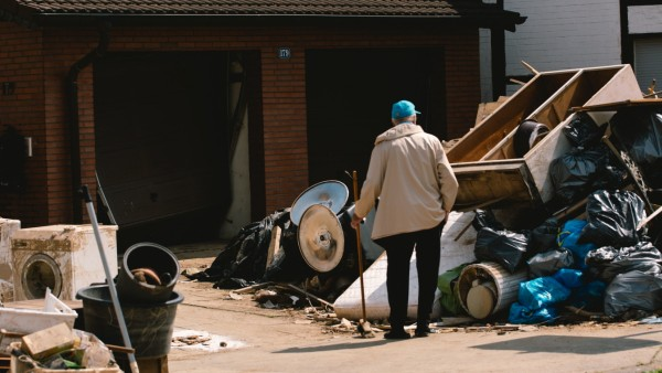Flood Aftermath In Erftstadt a man looks at a pile of destoyed furniture are seen outside in Erftstadt, Germany on July