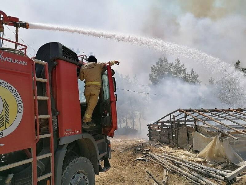 Fire fighters work to stop wild fires near Manavgat at Antalya, Turkey mediterranean coasts. More than 70 wildfires hav