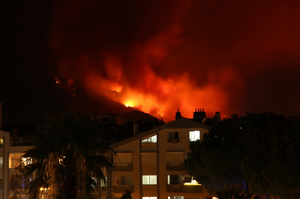 Forest fire in Marmaris Smoke and flames rise from a forest fire over residential buildings in Marmaris district in Mugl