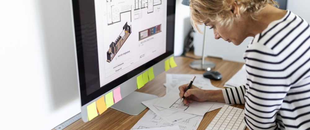 Female architect working on project in home office model released Symbolfoto property released PUBLICATIONxINxGERxSUIxAU