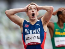 210803 Karsten Warholm of Norway celebrates after running on a new world record in men s 400 meter hurdle final during