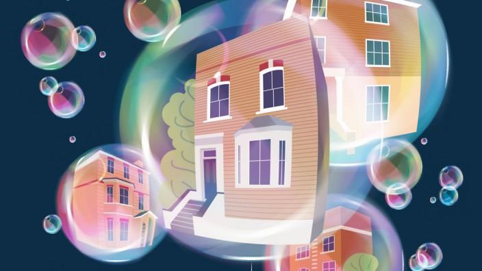 Hand mit einer Stecknadel bringt Immobilienblase zum Platzen PUBLICATIONxINxGERxSUIxAUTxONLY JamesxB