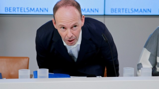 FILE PHOTO: German media group Bertelsmann CEO Rabe arrives for the annual news conference in Berlin
