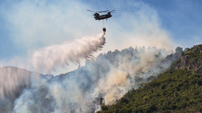 Athens Suburb Engulfed In Flames During Heatwave