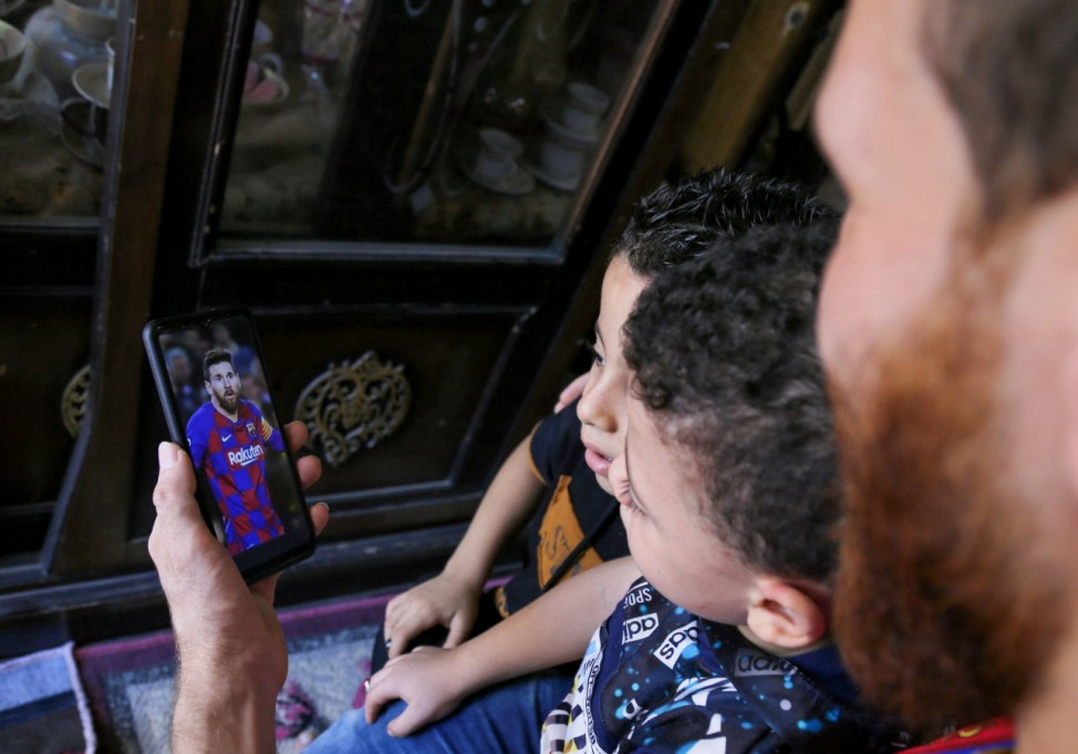 As Messi leaves Barcelona, his Egyptian lookalike joins millions of heavy-hearted fans