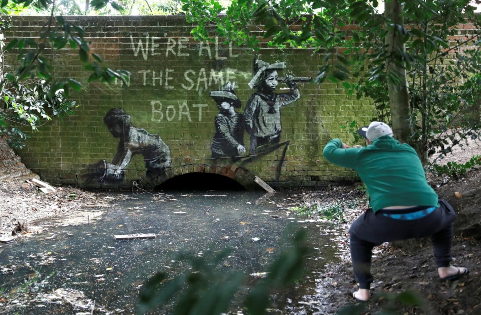 Artwork believed to be created by Banksy is photographed by a passer-by in Lowestoft