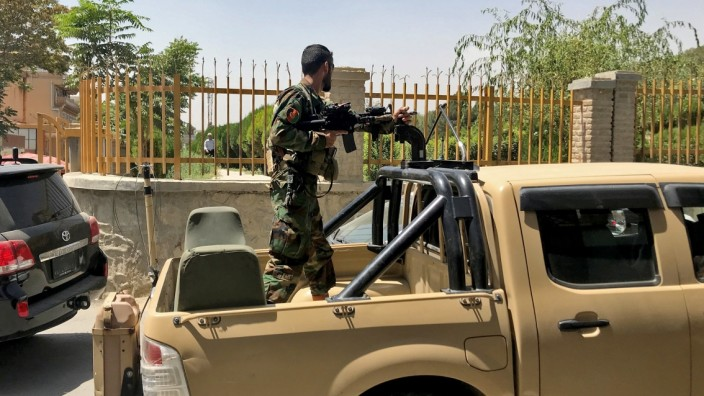 Afghan soldier stands in a military vehicle on a street in Kabul