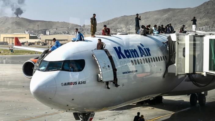 Thema der Woche: Chaos auf Kabuls Flughafen: Menschen versuchen, irgendwie das Land zu verlassen.