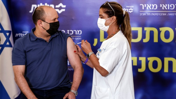 Israeli Prime Minister Naftali Bennett receives a third shot of COVID-19 vaccine in Kfar Saba