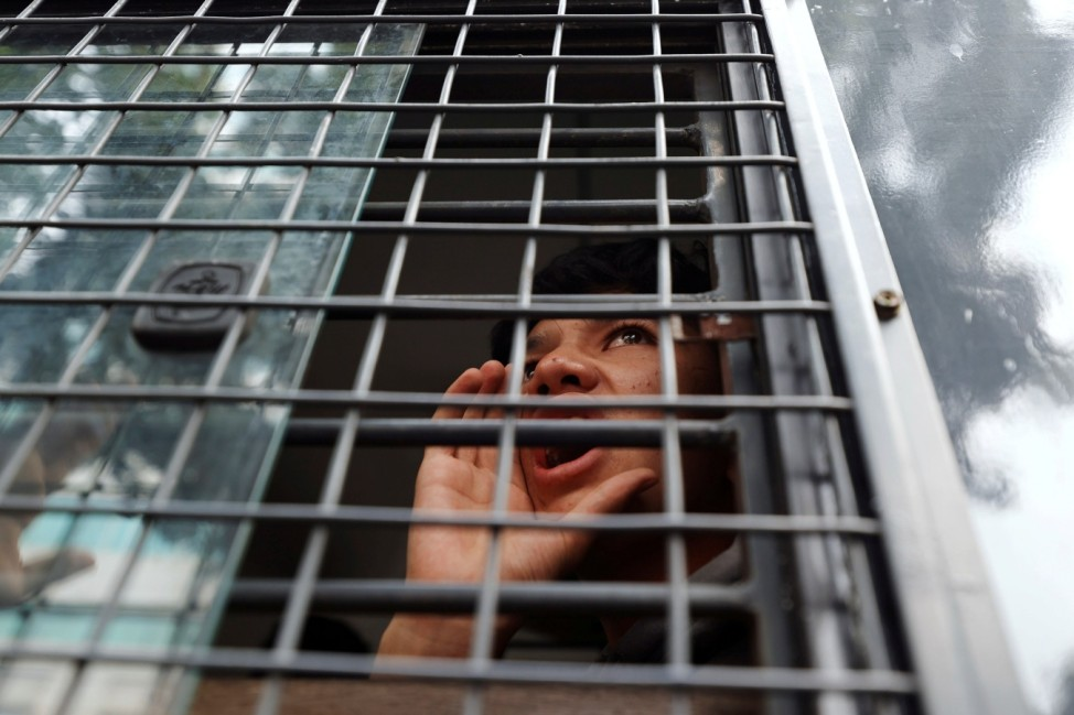 Afghan refugees in Indonesia protest outside the UN Refugee Agency UNHCR's office in Jakarta