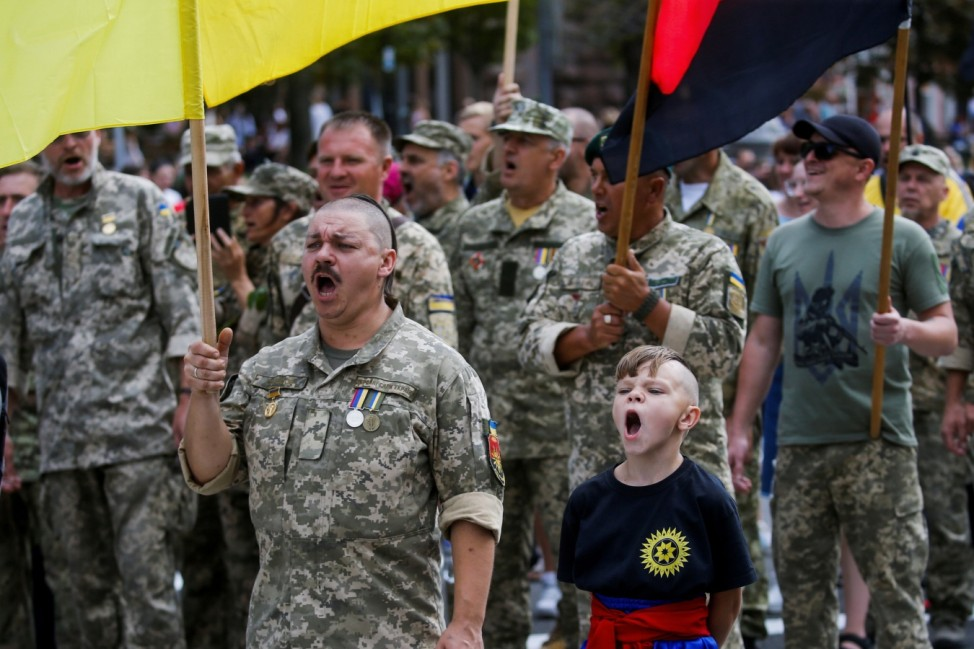 Ukrainians take part in the March of Defenders of Ukraine in Kyiv