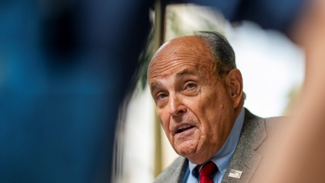 Former New York City Mayor Giuliani speaks to media about the U.S. evacuation of Afghanistan outside his apartment building in New York
