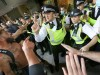 August 9, 2021, London, United Kingdom: Police officers stop protesters from accessing Studioworks during the demonstrat