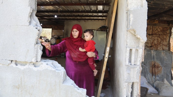 August 28, 2021, Gaza city, Gaza Strip, Palestinian Territory: A Palestinian family inspect their home destroyed by Isra