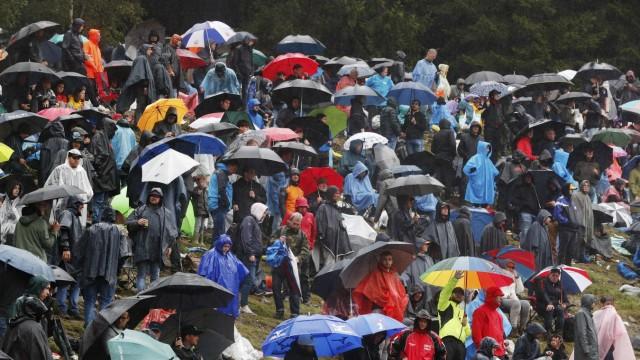 Formula 1 2021: Belgian GP CIRCUIT DE SPA FRANCORCHAMPS, BELGIUM - AUGUST 29: Fans under umbrellas during a red flag pe