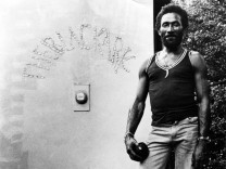 Musician Lee âĘScratchâÄÖ Perry Dies aged 85 Photo of UPSETTERS and Lee PERRY