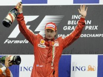 - FRANCORCHAMPS, BELGIUM: L-R, second placed Italian Giancarlo Fisichella of Force India and winner Finnish Kimi Raikko