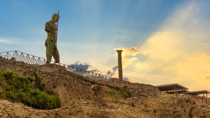POMPEII, ITALY - JULY 19, 2021: Archaeological Park of Pompeii at sunset. Sanctuary of Venus and the statue of Daedalus