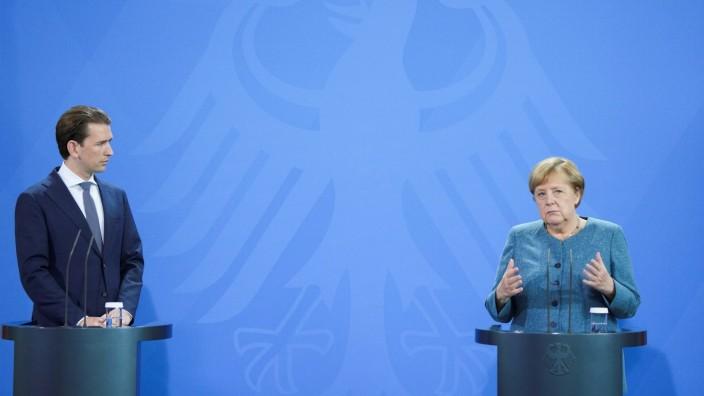 German Chancellor Angela Merkel and Austria's Chancellor Sebastian Kurz attend a news conference in Berlin