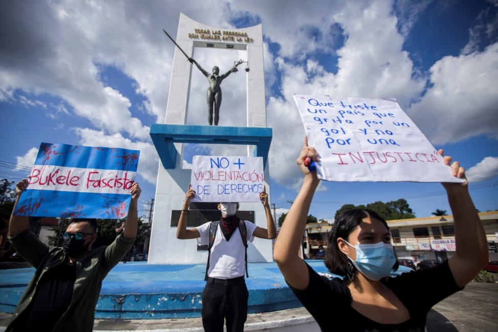 People protest against Nayib Bukele and a law approved by top court that allows his re-election in 2024, in San Salvador