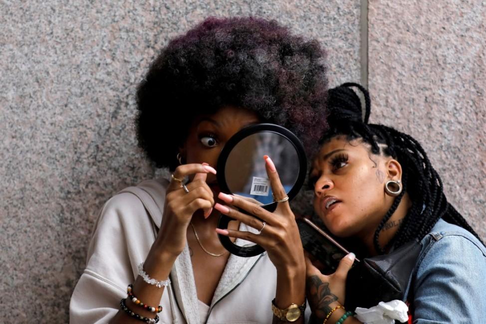 A model prepares backstage at Harlem Fashion Week in Manhattan, New York City