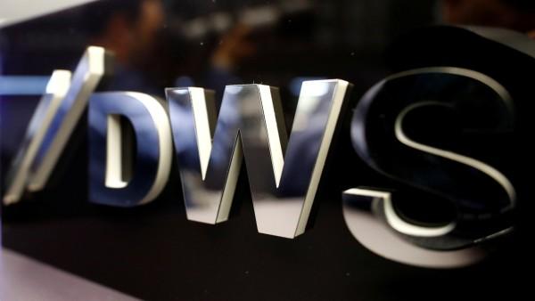 FILE PHOTO: Logo of Deutsche Bank's asset management unit DWS is pictured at the Frankfurt Stock Exchange