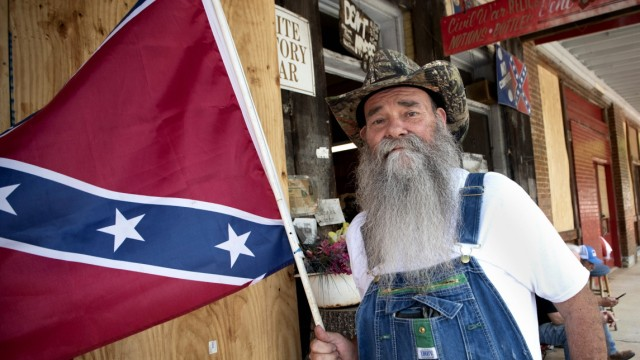June 14, 2020, Kennesaw, Ga: LAMARR MAYES, 64, from Fairmount, GA, holds his personal Confederate Battle Flag replica ou